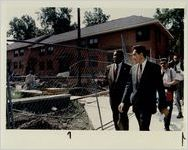 HUD Secretary Henry Cisneros tours Herndon Homes on Monday with AHA director Earl Phillips, August 10, 1993