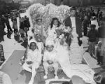Children from the Lutheran School on a Mardi Gras float in an African American neighborhood in Mobile, Alabama.