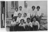 Father Arthur Allie sitting with ten Korean girls, Kosai, Korea, ca. 1930-1950