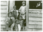"""Family of small landowner who moved out of the Santee-Cooper Basin, at their """"new home"""" near Bonneau, South Carolina"""