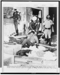 Los Angeles police drag young Negro from front of a looted store