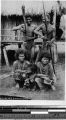 Five people in front of a house, Philippines, ca. 1920-1940