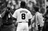 Bo Jackson shaking hands with a man during a Birmingham Barons baseball game in Birmingham, Alabama.