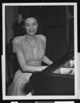 Red Cross worker Vivian Collier at the piano, Paris, 1946