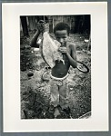 Young boy holding filleted fish
