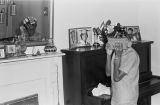 Josephine Bradford dusting the living room at her parents' home in Montgomery, Alabama.