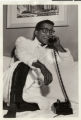Photograph of Sammy Davis, Jr. talking on the telephone