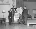 "Five members of the Jackson Street Community Council (JSCC) posing with their ""Comprehensive Plan for Seattle"", ca. 1957"