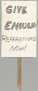 Protest sign calling for reparations for the Tulsa Riot