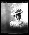 Vignetted portrait of young African American woman in fancy hat