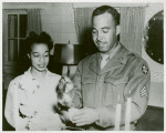 African American Sergeant Alton V. McSween pouring punch while his wife, Miss Letitia Lee Walker, employee of the Del Monte Avenue USO Club, looks on