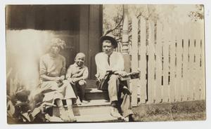 African American Family Sitting on Porch Steps