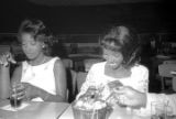 Susie Sanders Hubbard and another young woman, seated at a table at the Elks Club in Montgomery, Alabama, after her wedding.