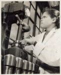 Youth testing hardness of metal, Brooklyn Work Experience Center