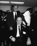 Bill Clinton standing behind Kenneth Hahn in his wheelchair, Los Angeles, 1992