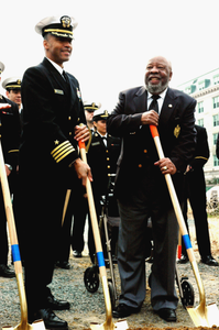 Shovels in hand, the US Navys (USN) first African American Commandant of the US Naval Academy (USNA), Captain (CAPT) Bruce Grooms (left), stands with Retired USN Lieutenant Commander (LCDR) Wesley Brown at the groundbreaking ceremony of the Wesley Brown Field House at the US Naval Academy, at Annapolis, Maryland (MD)
