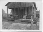 Couple Sitting on Porch (Clay County, Miss.)