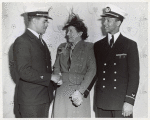 Thumbnail for Two African American crew members (at left: Walter E. Harris, Jr., deck engineer; at right: William E. Simmons, Jr., Warrant Officer) of the Liberty ship SS Robert L. Vann shaking hands with Mrs. Jessie Matthews Vann (Robert L. Vann's widow) on the day of the launching
