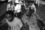 Police officers arresting a civil rights demonstrator during the Children's Crusade in Birmingham, Alabama.