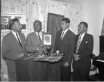 Four men with book, Los Angeles, 1965