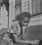 Black child leaning on arm, San Francisco