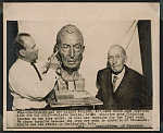 Albert Woolson, 107, lone Union Army survivor sits for his bust Kalervo Kallio, noted sculptor puts finishing touches on the clay model.