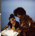 Series of two Polaroid photographs of Marzette Lewis with her Charles I. West Middle School math class