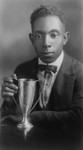 Young man with an academic trophy