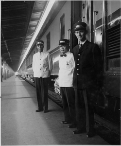 Pullman porters and conductor on train platform: photoprint