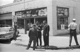 Thumbnail for Public safety commissioner Bull Connor speaking to two African American men in front of M&F Record Suppliers in Birmingham, Alabama, during the Children's Campaign.