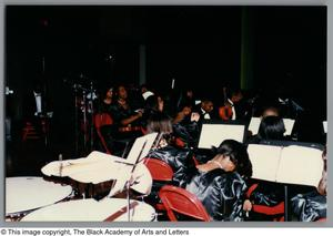 Photograph of students resting their instruments Christmas/Kwanzaa Concert Hallelujah Hip Hop Concert, December 1995
