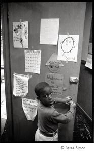 Young boy at the classroom door, Liberation School