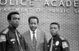 Representative Thomas Reed with Leon Hampton and Elbert Dawson, two of the first three African American state troopers ever hired in Alabama.