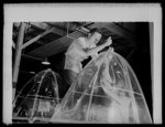 Manpower. Negro bomber plant workers. American manpower draws its skills from various racial groups alike. Here, in a large Eastern bomber plant, huge transparent plastic bomber noses are being conditioned for installation on planes which will carry America's offensive to the far corners of the world. Glenn L. Martin Bomber Plant. Baltimore, Maryland