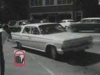 Thumbnail for WSB-TV newsfilm clip of civil rights movements and Albany city officials entering the Federal Building in Albany, Georgia, 1962 July