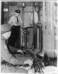 [First African American motorman in Philadelphia, Thomas Allen, leaves trolley barn under police escort]