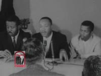Series of WSB-TV newsfilm clips of a press conference with comments by Dr. Martin Luther King, Jr. about the Freedom Ride, Montgomery, Alabama, 1961 May 23