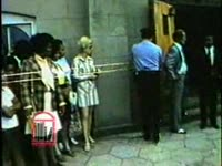 WSB-TV newsfilm clip of crowds waiting outside of Ebenezer Baptist Church as the body of Alberta Williams King, mother of Dr. Martin Luther King, Jr., lies in state, Atlanta, Georgia, 1974 July 2