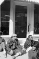 Students from Tuskegee Institute seated on the sidewalk outside Keever's, during a demonstration to protest the murder of Samuel L. Younge, a civil rights worker.