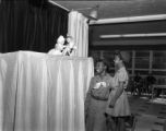 Girl Scouts watch a puppet show