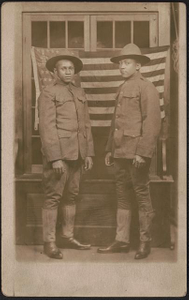 Thumbnail for [Two unidentified African American soldiers in uniforms and campaign hats standing in front of American flag]