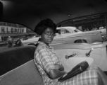 Young woman in the back of a police car after participating at a sit-in demonstration in Birmingham, Alabama.