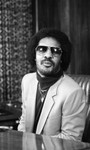 Stevie Wonder siting at a table in an office, Los Angeles