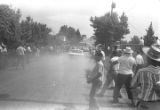 """Car driving down a dirt road by participants in the """"March Against Fear"""" through Mississippi, begun by James Meredith."""