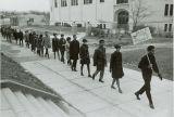 Civil rights demonstrators march single file