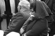 Alberta Williams King pressing a handkerchief to her face during Martin Luther King, Jr.'s funeral at South View Cemetery.