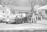 Group standing in the parking lot, possibly of a church building in Autauga County, Alabama.