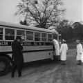 Police officers at the door of a school bus during the attempted integration of several high schools in Macon County, Alabama.
