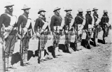 24th Infantry on campaign duty lined up with an experimental blanket roll they were testing for the U.S. Army.