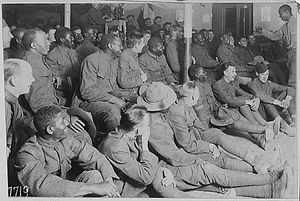 [African American] trooper entertaining his comrades in the American Red Cross Recreation Hut at Orl...